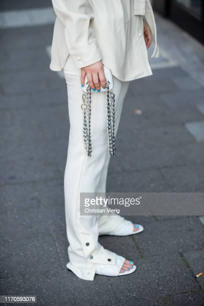 Maria Barteczko is seen wearing cream white leather shirt Papèr Moon white pants Zara white padded slipper Zara white mini chain bag KARA on August...