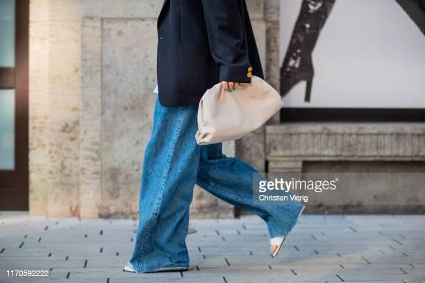 Maria Barteczko is seen wearing dark blue oversized blazer Saint Laurent, white oversized blouse Zara, wide leg jeans Zara, white padded slipper...