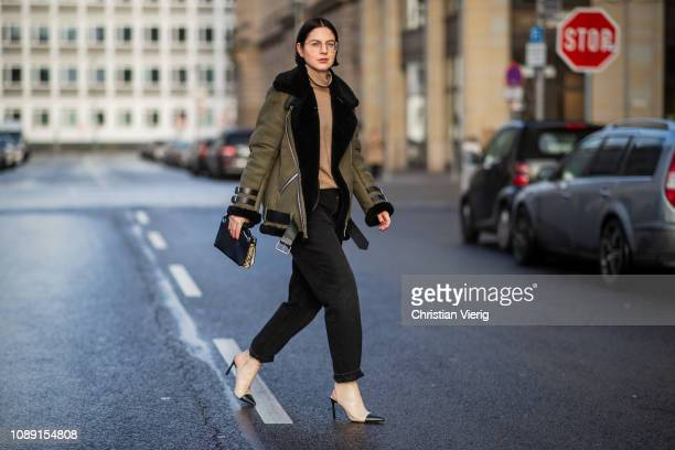 Maria Barteczko is seen wearing green shearling jacket Ducie brown cashmere turtleneck Burberry dark washed mom jeans Citizens of Humanity two tone...