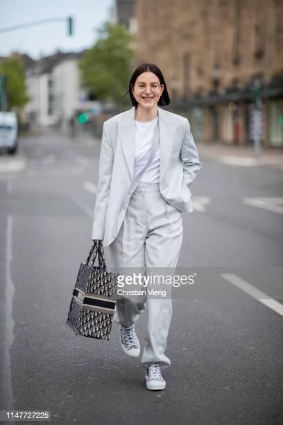 Maria Barteczko is seen wearing grey linen oversized blazer Stella McCartney white tshirt The Row grey inen wide leg trousers Stella McCartney logo...
