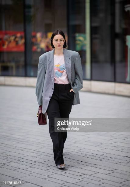 Maria Barteczko is seen wearing grey oversized blazer Mise Paris light pink dumbo shirt Loewe black wide trousers Proenza Schouler logo houndstooth...