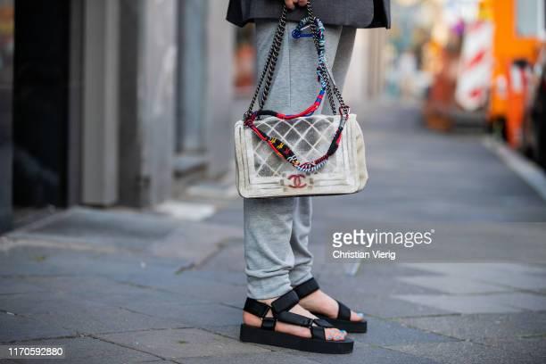 Maria Barteczko is seen wearing grey sweatpants Nike, black chunky hiking sandals Asos, graffiti canvas bag Chanel on August 25, 2019 in Duesseldorf,...