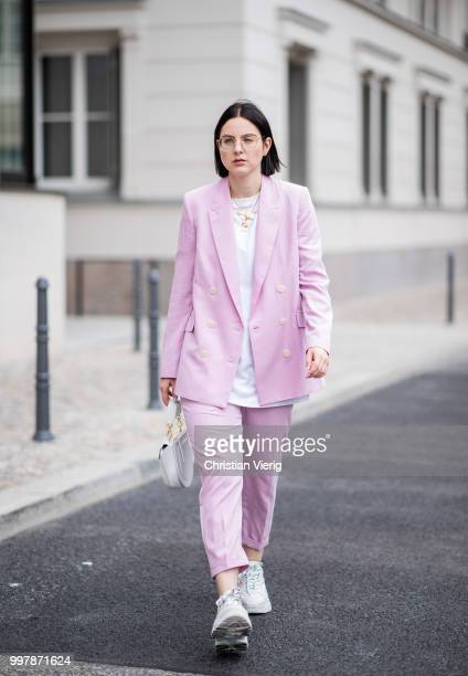 Maria Barteczko is seen wearing light pink suit Mango white cotton oversized top Acne Studios white Addict sneaker ASH letter necklace Celine shell...
