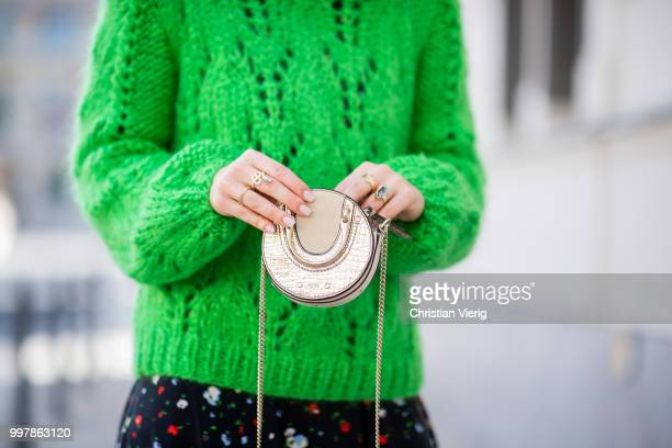 Maria Barteczko is seen wearing long flower printed dress Ganni green oversized mohair sweater Ganni white outburst sneaker Nike mini metallic bag...