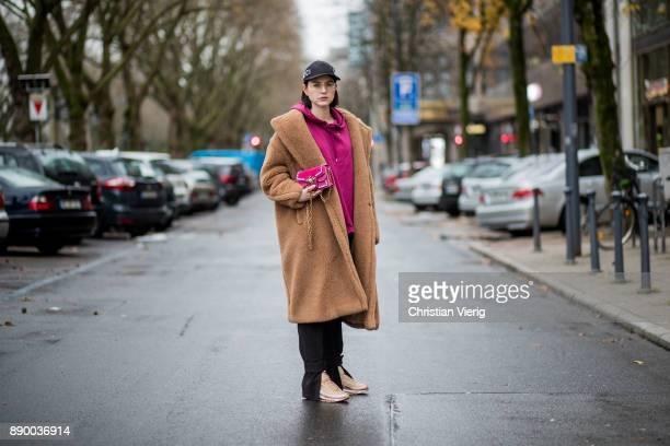 Maria Barteczko wearing a camel iconic teddy coat Max Mara burgundy hoodie Asos black slim ankle trousers HM metallic Air Max 97 Ultra 17 Niike mini...