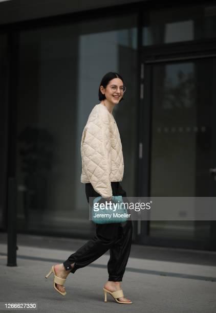 Maria Barteczko wearing Arket beige quilted jacket, Zara black leather cargo pants, Zara yellow strap sandals, Bottega Veneta blue Jodie mini bag and...