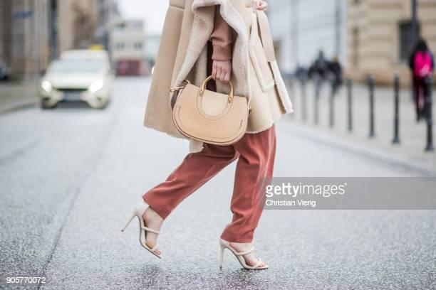 Maria Barteczko wearing beige lambskin cape Chloe beige printed wool sweater Chloe wide leg silk pants Mango lambskin headband UGG nude high heels...