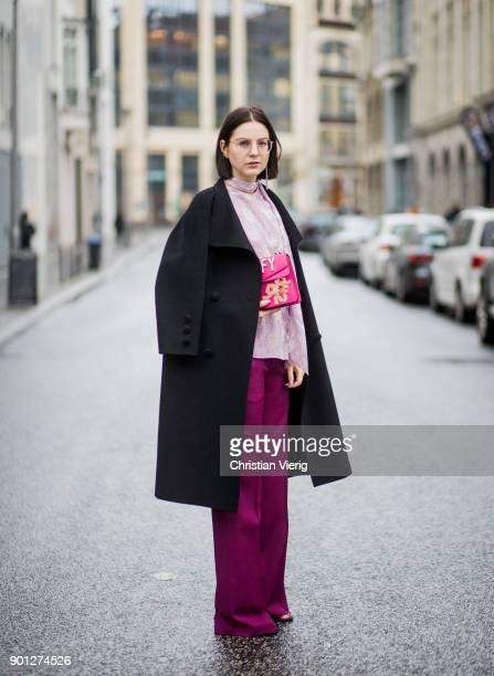 Maria Barteczko wearing black long vintage wool coat Saint Laurent glasses purple ruffled blouse with trumpet sleeves Chloe pink wide leg palazzo...