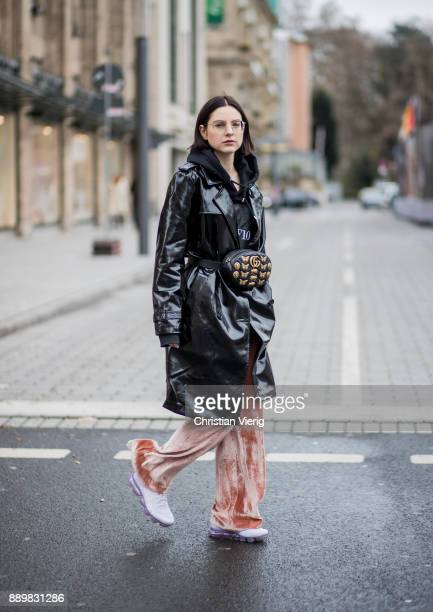 Maria Barteczko wearing black shiny vinyl trench coat Asos black hoody MUF10 nude velvet wide leg trousers AliceOlivia purple Air Max sneaker Nike...