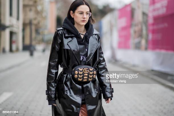 Maria Barteczko wearing black shiny vinyl trench coat Asos black hoody MUF10 nude velvet wide leg trousers AliceOlivia purple Air Max sneaker Nike...