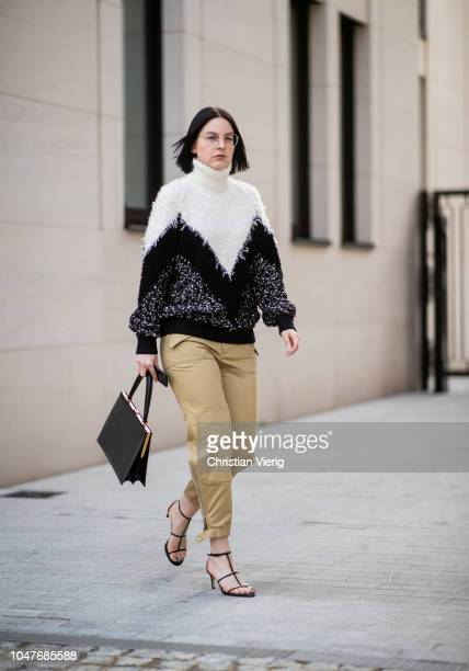 Maria Barteczko wearing black white two tone turtleneck wool sweater Givenchy beige cargo pants Chloe leather strap sandals Zara black Clasp bag...
