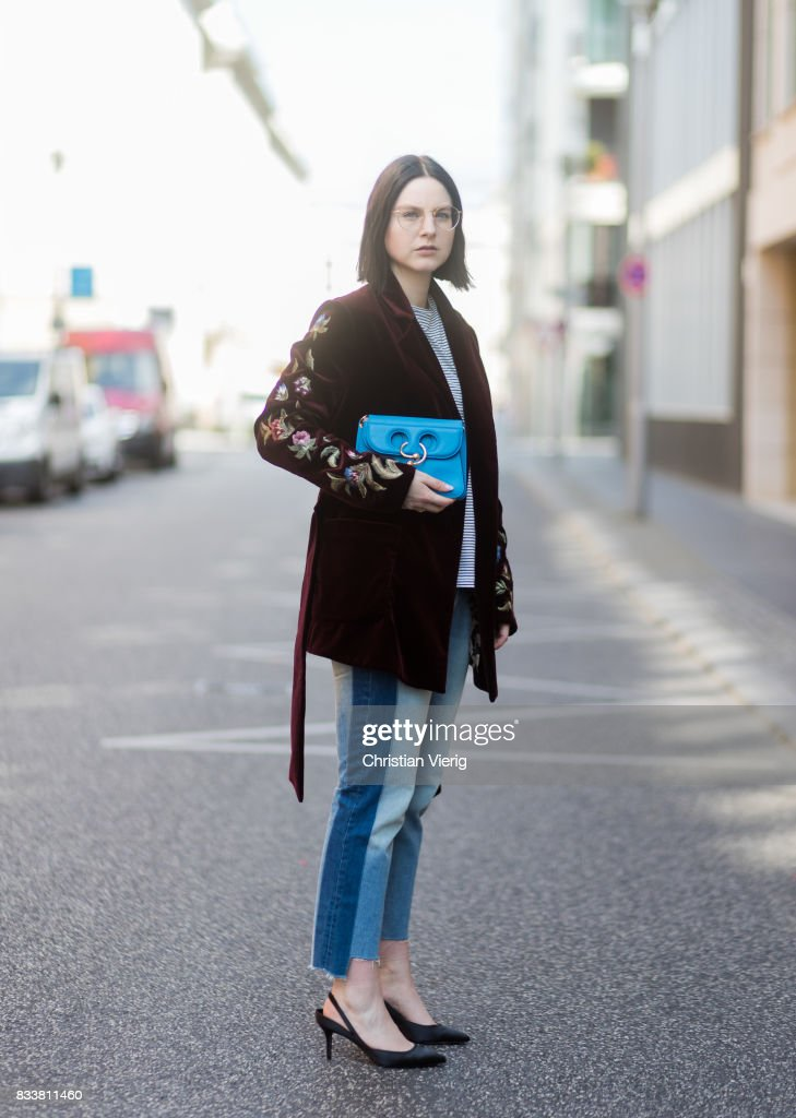 Maria Barteczko wearing bordeaux floral velvet jacket Bazar Deluxe, striped shirt Isabel Marant Etoile, reworked jeans Zara, black satin slingbacks Gianvito Rossi, small light blue pierce bag JW Anderson, round gold glasses Ray Ban on August 17, 2017 in Berlin, Germany.
