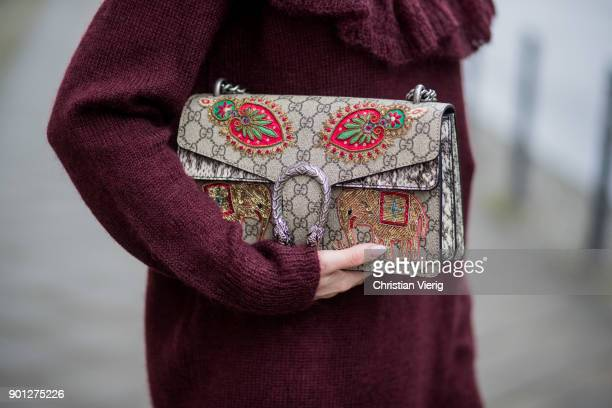 Maria Barteczko wearing floral wide leg palazzo pants Valentino bordeaux oversized sweater with ruffles Stella McCartney embroidered Dionysus bag...