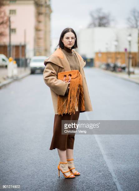 Maria Barteczko wearing glasses brown long tube dress Zara brown oversized sweater Celine beige hooded jacket Mariam Al Sibai orange heels Missguided...