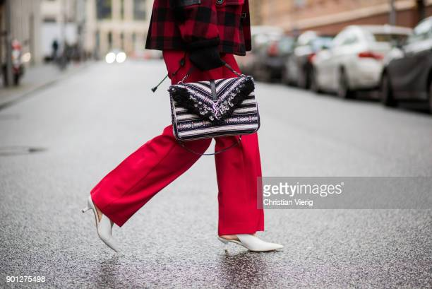 Maria Barteczko wearing glasses red checked jacket Dsquared 2 oversized mohair sweater Maiami red wide leg pants Mango white slingback pumps Zara bag...