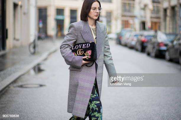 Maria Barteczko wearing grey checked long coat Stella McCartney gold glitter top Stella McCartney animal printed wide leg pants Stella McCartney...