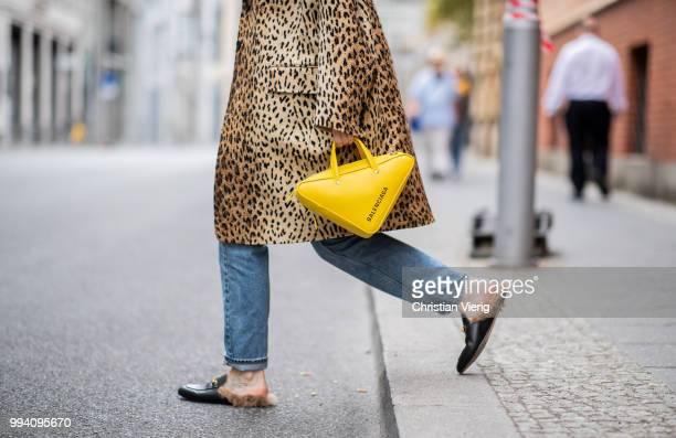Maria Barteczko wearing leopard print coat Valentino black Villalo cashmere top used Monki boyfriend jeans black fur slipper Gucci yellow triangle...