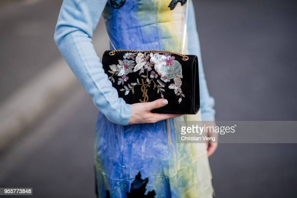 Maria Barteczko wearing light blue cashmere sweater Allude multicolor lace slip dress Celine black ankle boots Balenciaga black mini bag with tassels...