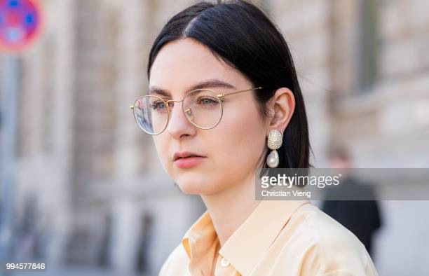 Maria Barteczko wearing light yellow silk blouse The Row grey logo wide leg trousers Celine yellow buckle slipper Mango black leather belt bag Stella...
