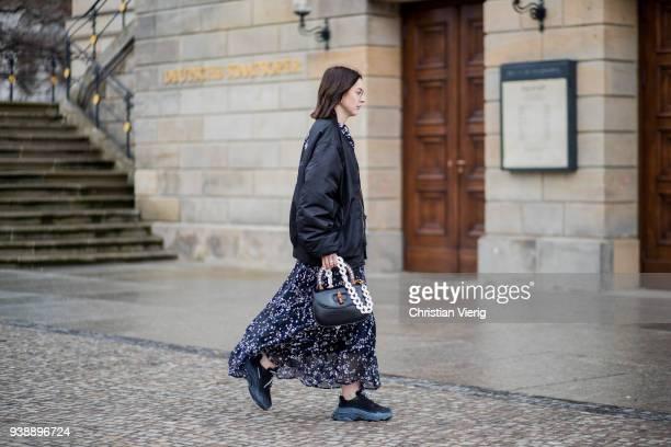 Maria Barteczko wearing long floral maxi dress Isabel Marant black oversized bomber jacket MUF10 triple S sneaker Balenciaga black bamboo bag Gucci...