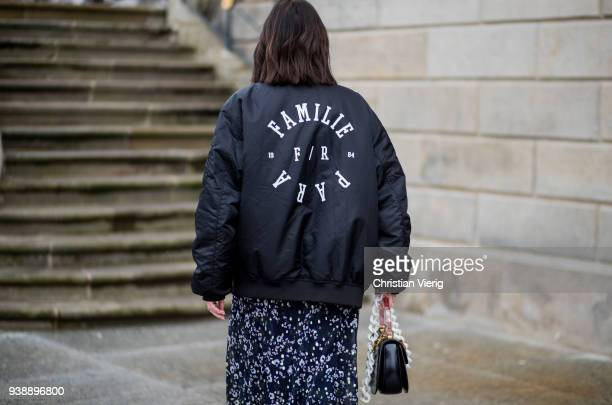Maria Barteczko wearing long floral maxi dress Isabel Marant black oversized bomber jacket MUF10 triple S sneaker Balenciaga black bamboo bag Gucci...