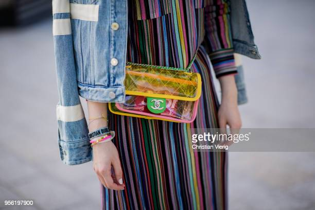 Maria Barteczko wearing multi color long striped polo dress Missoni light denim jacket Givenchy PVC belt flat bag Chanel white deerupt sneakers...