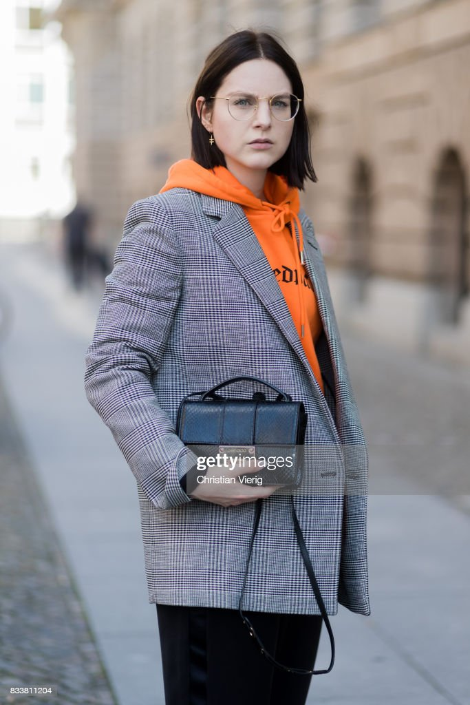 Maria Barteczko wearing orange hoodie Wasted Paris, oversized checked blazer in grey Stella McCartney, wide leg black trousers H&M, black heels Gianvito Rossi, black python printed bag Jimmy Choo, round glasses Ray Ban on August 17, 2017 in Berlin, Germany.