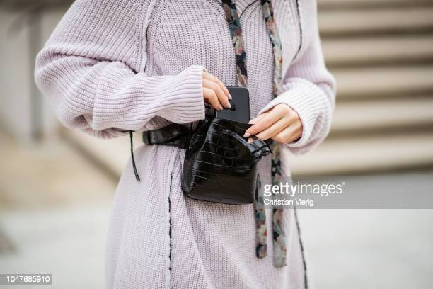 Maria Barteczko wearing oversized v neck sweater Circus Hotel floral silk maxi dress Zimmermann laced leather boots ATP Atelier croco bucket belt bag...