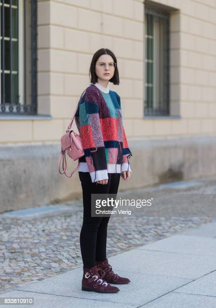 Maria Barteczko wearing patchwork oversized wool sweater Stella McCartney, black skinny jeans Madewell, red buckle boots with studs Givenchy, silver...