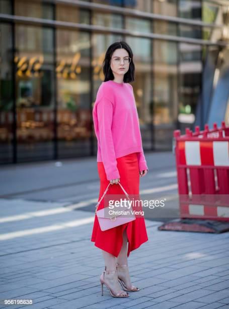 Maria Barteczko wearing pink cashmere sweater Valentino, red silk asymmetric midi skirt Victoria Beckham, light pink bag JW Anderson, light pink...