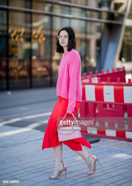 Maria Barteczko wearing pink cashmere sweater Valentino, red silk asymmetric midi skirt Victoria Beckham, light pink bag JW Anderson, light pink...