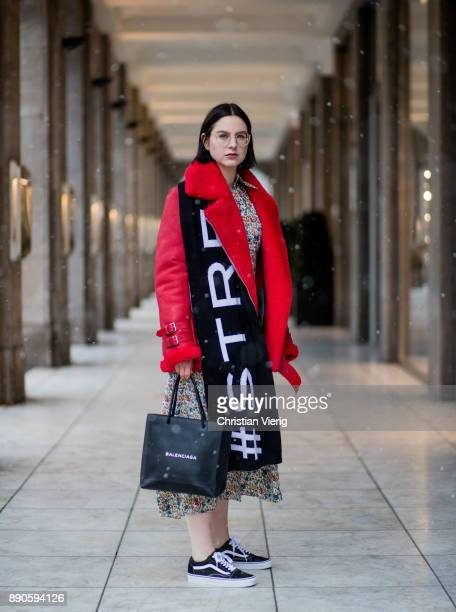Maria Barteczko wearing red leather shearling aviator jacket Ducie long floral printed dress Joseph black shopping bag Balenciaga wool logo scarf...