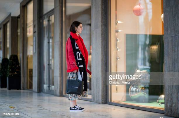 Maria Barteczko wearing red leather shearling aviator jacket Ducie long floral printed dress Joseph black shopping bag Balenciaga wool logo scarf...
