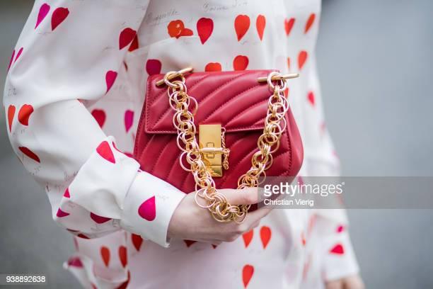 Maria Barteczko wearing white heart printed blouse Alexander McQueen red cropped pants Alexander McQueen white high heel sandals Giuseppe Zanotti red...