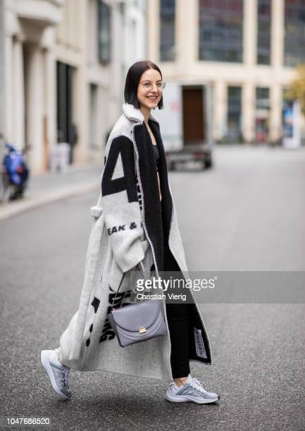 Maria Barteczko wearing wool coat Celine black cropped top 032c black leggings Balenciaga sneakers Nike necklace Suenos letter grey bag Wandler is...