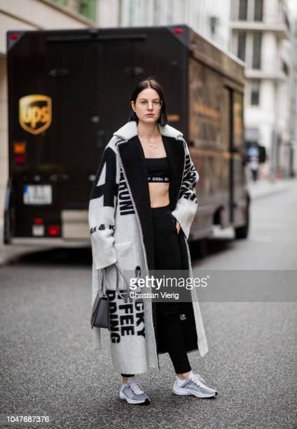 Maria Barteczko wearing wool coat Celine black cropped top 032c black leggings Balenciaga sneakers Nike necklace Suenos letter grey bag Wandler is...