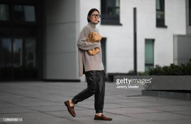 Maria Barteczko wearing Zara beige wool turtleneck, Zara black leather cargo pants, Mango beige pouch, Zara brown animal printed loafer and Victoria...