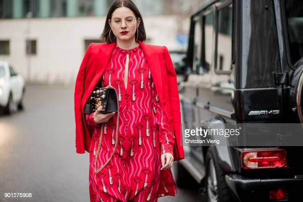 Maria Barteczko with red lipstick wearing red blazer Alexander McQueen red lipstick printed dress Valentino black tights Wolford black ankle boots...