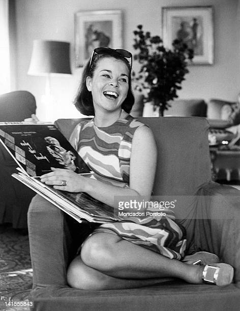 Maria Beatrice of Savoy laughing while holding some records Italy 1967