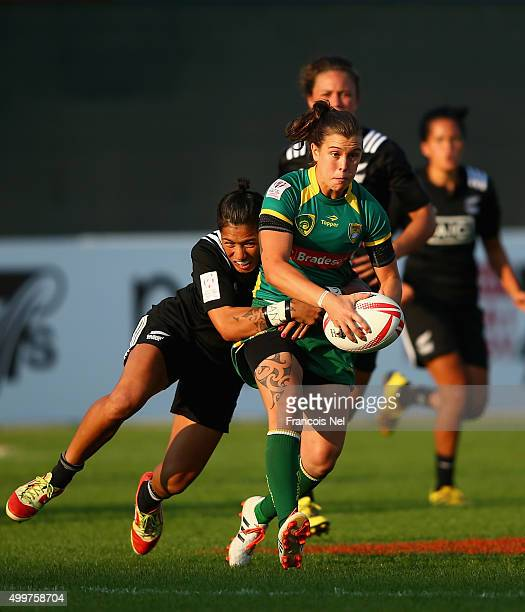 Maria Behrendt of Brazil in action against New Zealand during day one of the Women's HSBC Sevens World Series at The Sevens Stadium on December 3...