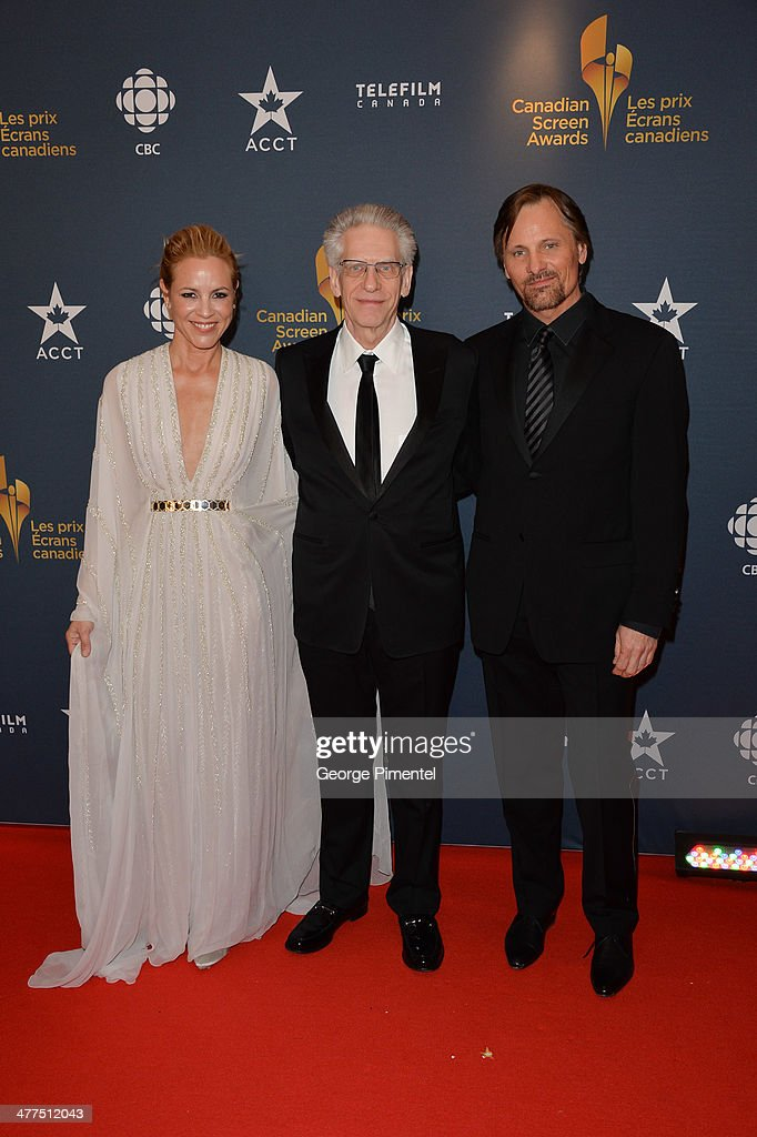 Maria Bello, David Cronenberg and Viggo Mortensen arrive at the Canadian Screen Awards at Sony Centre for the Performing Arts on March 9, 2014 in Toronto, Canada.