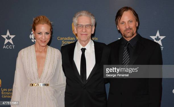 Maria Bello David Cronenberg and Viggo Mortensen arrive at the Canadian Screen Awards at Sony Centre for the Performing Arts on March 9 2014 in...