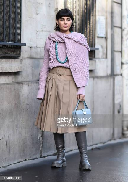 Maria Bernad is seen wearing a purple sweater, beige skirt, Lanvin bag and boots with a teal necklace outside the Lanvin show during Paris Fashion...