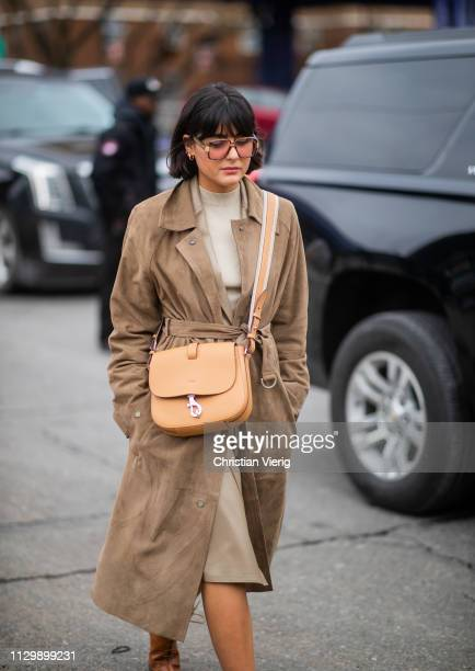 Maria Bernad is seen wearing brown belted coat, bag outside Boss during New York Fashion Week Autumn Winter 2019 on February 13, 2019 in New York...