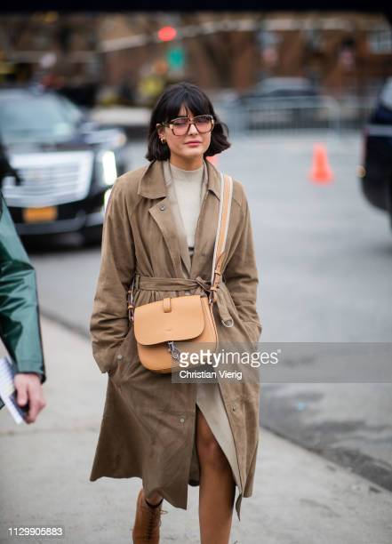Maria Bernad is seen wearing brown belted coat bag outside Boss during New York Fashion Week Autumn Winter 2019 on February 13 2019 in New York City