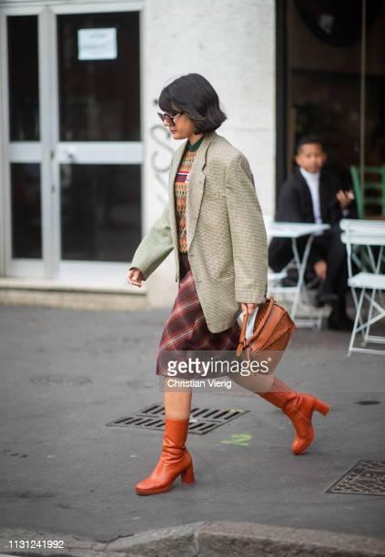 Maria Bernad is seen wearing Loewe bag plaid blazer skirt ankle boots outside Max Mara on Day 2 Milan Fashion Week Autumn/Winter 2019/20 on February...