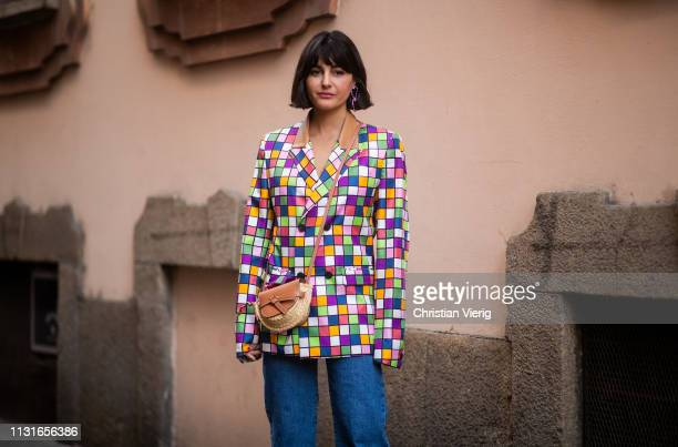 Maria Bernad is seen wearing plaid jacket Loewe bag denim jeans outside Vivetta on Day 2 Milan Fashion Week Autumn/Winter 2019/20 on February 21 2019...