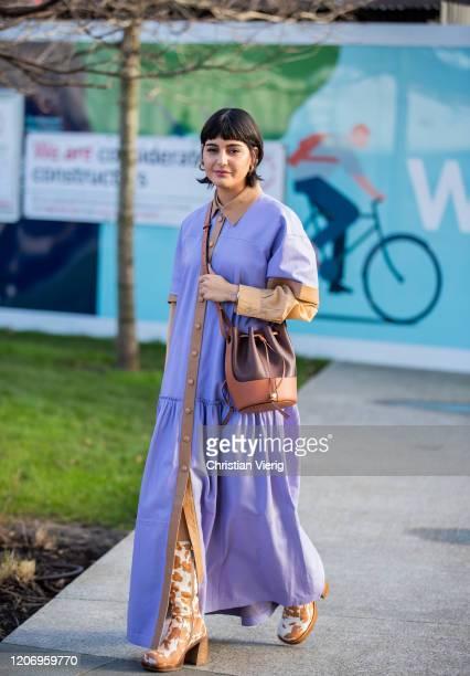 Maria Bernad is seen wearing purple dress, brown bucket bag outside Christopher Kane during London Fashion Week February 2020 on February 17, 2020 in...