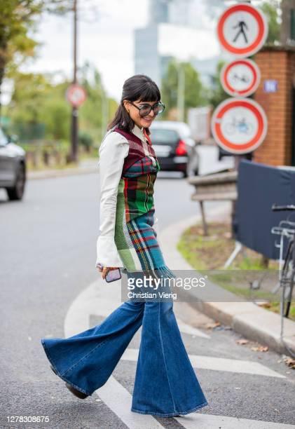 Maria Bernad seen wearing flared denim jeans, checkered dress, white button shirt, Dior bag outside Hermes during Paris Fashion Week - Womenswear...