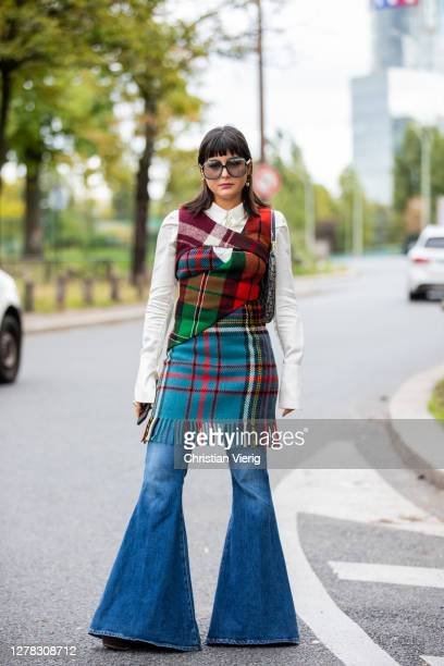 Maria Bernad seen wearing flared denim jeans, checkered dress, white button shirt, Dior bag outside Hermes during Paris Fashion Week - Womenswear...